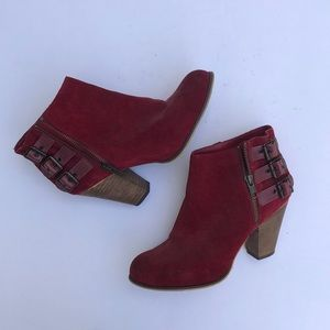 Red suede booties with buckles